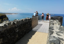 Visitors take advantage of the new viewpoint, gazing to Portrush to the West, and Dunluce Castle to the East